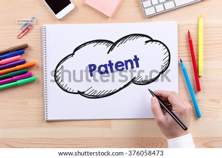 Man with a Notepad written Patent Concept - stock photo
