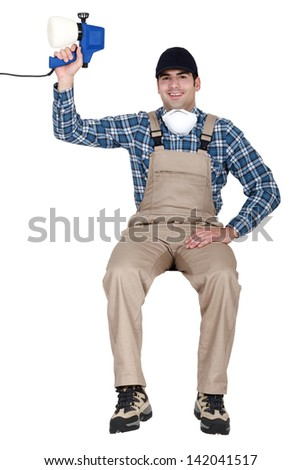 Man with a paint sprayer - stock photo