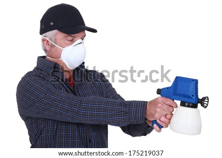 Man with a paintsprayer - stock photo