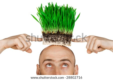 Man with a patch of green grass on his head.  Isolated against a white background. - stock photo