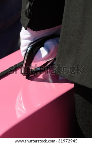 Man with a pink suitcase - stock photo