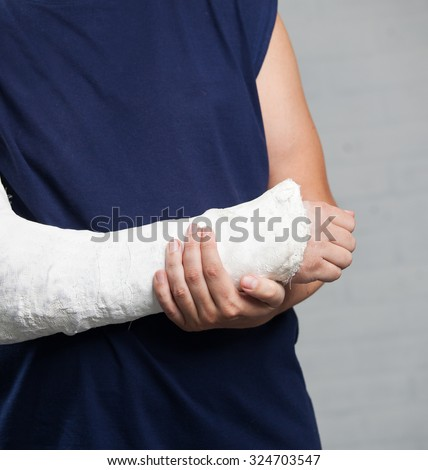 Man with a plaster. Broken arm, shoulder. Injury - stock photo