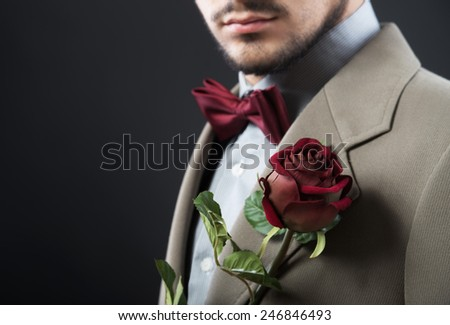 Man with a single rose - stock photo