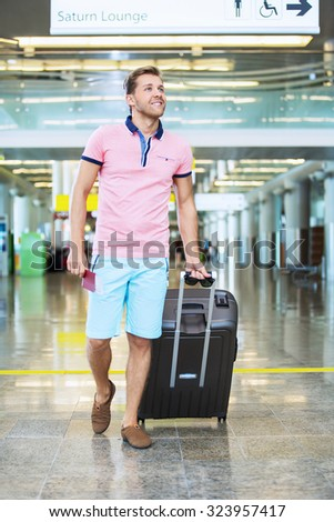 Man with a suitcase at the airport - stock photo