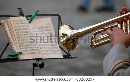 man with a trumpet, read music note - stock photo