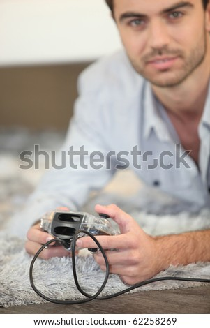 Man with a video game controller - stock photo