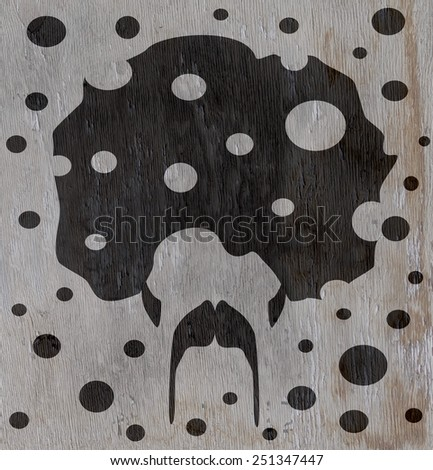 man with afro design on wood grain texture - stock photo