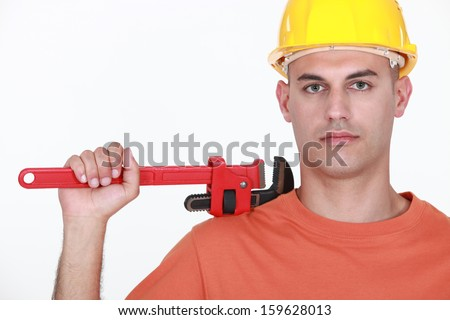Man with an adjustable wrench - stock photo