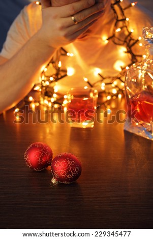 man with an alcohol problem drinking on Christmas - stock photo
