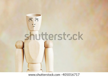 Man with an empty head. Abstract image with wooden puppet - stock photo