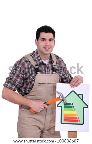 Man with an energy rating symbol - stock photo