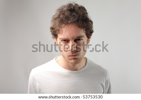 Man with angry expression - stock photo