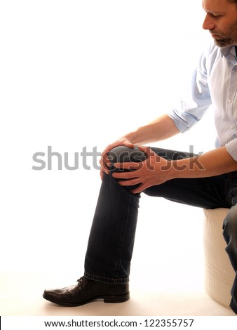 Man with anterior knee pain, white background with space for text - stock photo