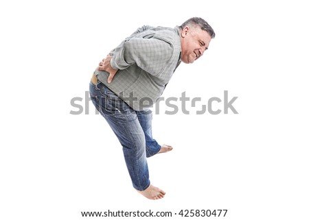 Man with back pain. Hands on lower back. People, health care and problem concept - unhappy man suffering. White background. - stock photo