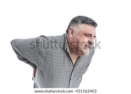 Man with back pain. People, health care  and problem concept - unhappy man suffering. White background. Full length picture. - stock photo