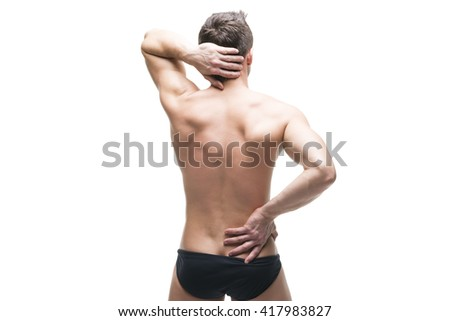 Man with backache. Pain in the human body. Muscular male body. Isolated on white background. Middle part of the body - stock photo