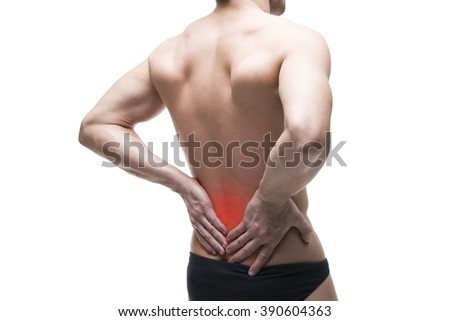 Man with backache. Pain in the human body. Muscular male body. Isolated on white background with red dot - stock photo