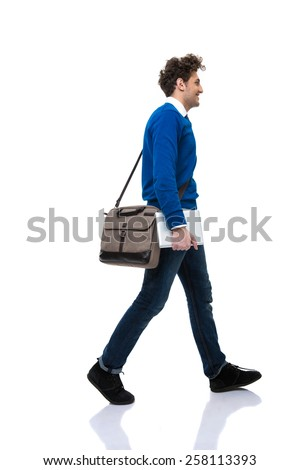 Man with bag walking over white background - stock photo