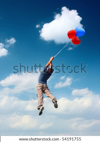 Man with balloons flying in blue cloudy sky - stock photo