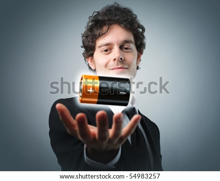 man with battery in his hand - stock photo