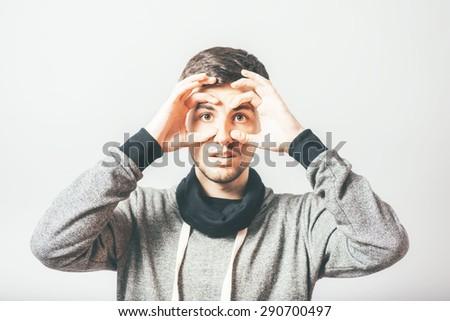 man with binoculars - stock photo