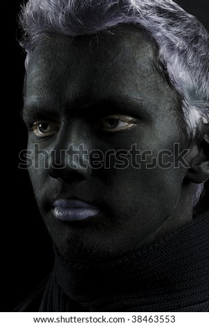 Man with black face - stock photo