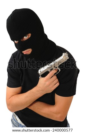Man with black mask and blue eyes with a gun, Isolated on white - stock photo