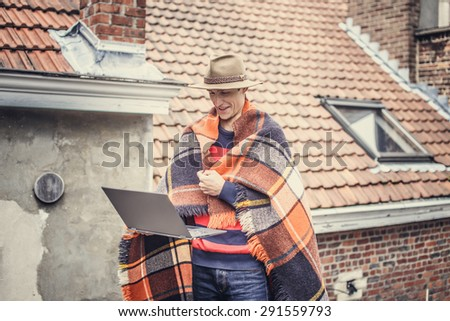 Man with blanket on the roof. - stock photo