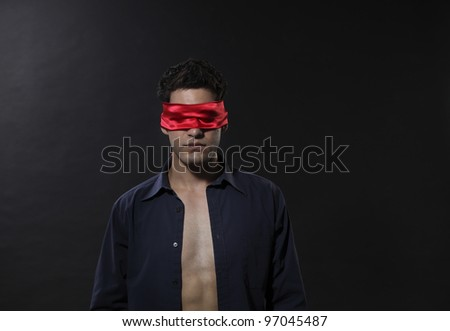 man with blindfolded with red cloth - stock photo