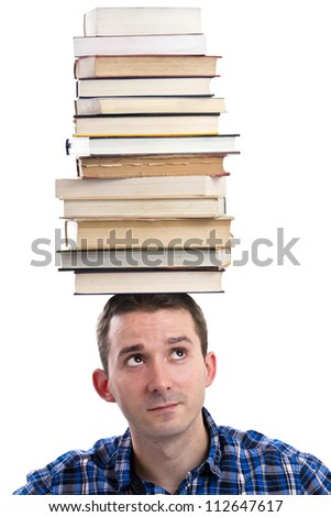 Man with books on his head - stock photo