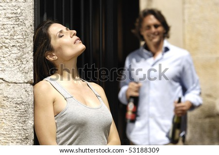 man with bottles and woman tanning - stock photo