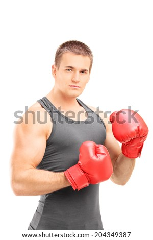 Man with boxing gloves posing isolated on white background - stock photo