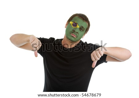 man with brazilian flag painted on his face showing two thumbs down, isolated on white background - stock photo