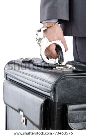 Man with briefcase and handcuffs - stock photo