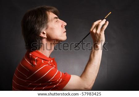 Man with brush - stock photo