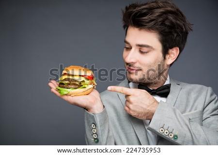 man with burger  - stock photo