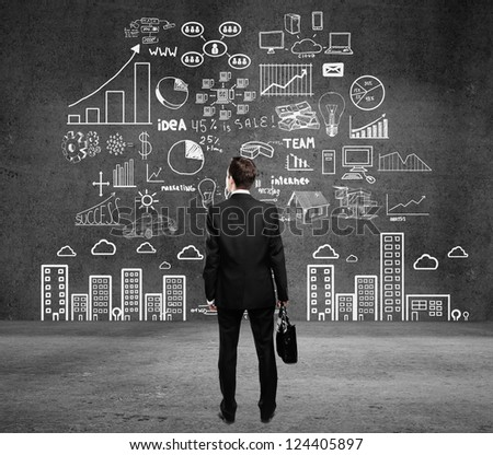 man with business plan concept on wall - stock photo