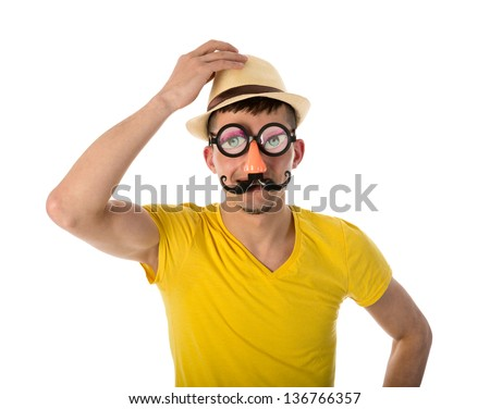 Man with carnival mask and hat isolated over white - stock photo