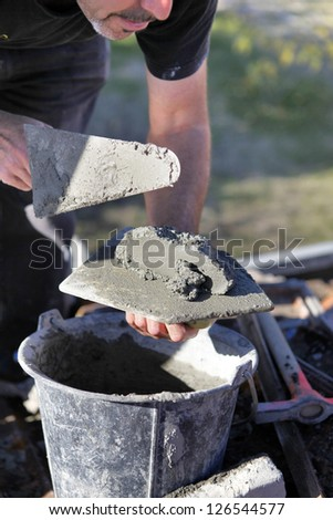 Man with cement and trowel - stock photo