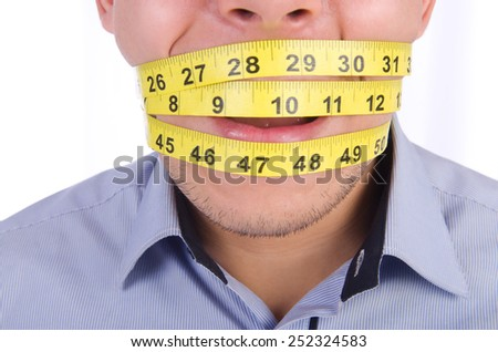 Man with centimeter in dieting concept - stock photo