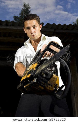 man with chainsaw - stock photo