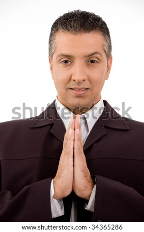 Man with clasped hands against white background - stock photo