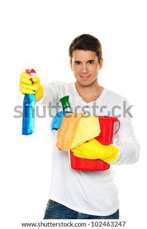 man with cleaning fluid. cleaning the apartment. hausmannbei apartment cleaning in spring - stock photo