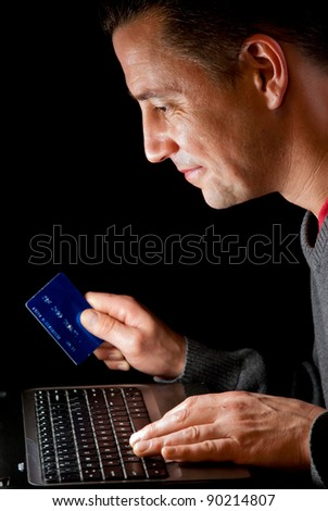 man with credit card online shopping - stock photo