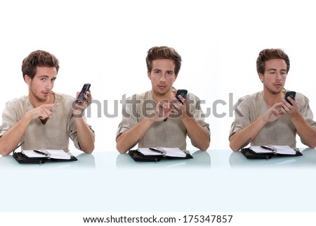 Man with diary typing text message - stock photo