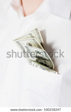 Man with dollars in pocket isolared on white - stock photo