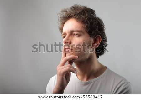 Man with doubtful expression - stock photo
