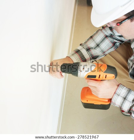 man  with electric drill  - stock photo
