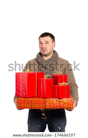 Man with emotion surprised holding a gift box in her hand. Man with red gift box with ribbon on white background. Happy young man holding a lot of boxes with gifts, isolated on white. On holiday. - stock photo