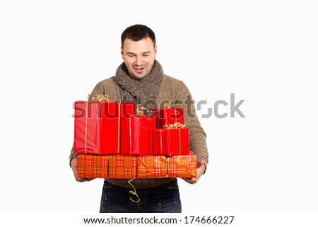 Man with emotions of surprise holding gift boxes in hand. With a gift box wrapped in red paper with ribbon. Man holding a lot of boxes with gifts isolated on white background. Bought a lot of gifts. - stock photo